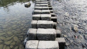 stone steps across the water in seattle are an example of mindfulness tools to help you better navigate the stress of life challenges